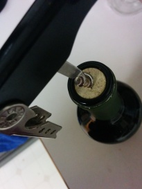 Uncorking a wine bottle